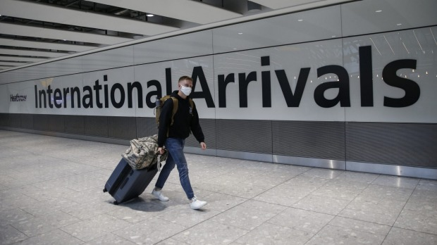 Asia Today- Australia slices traveler numbers to stop variation